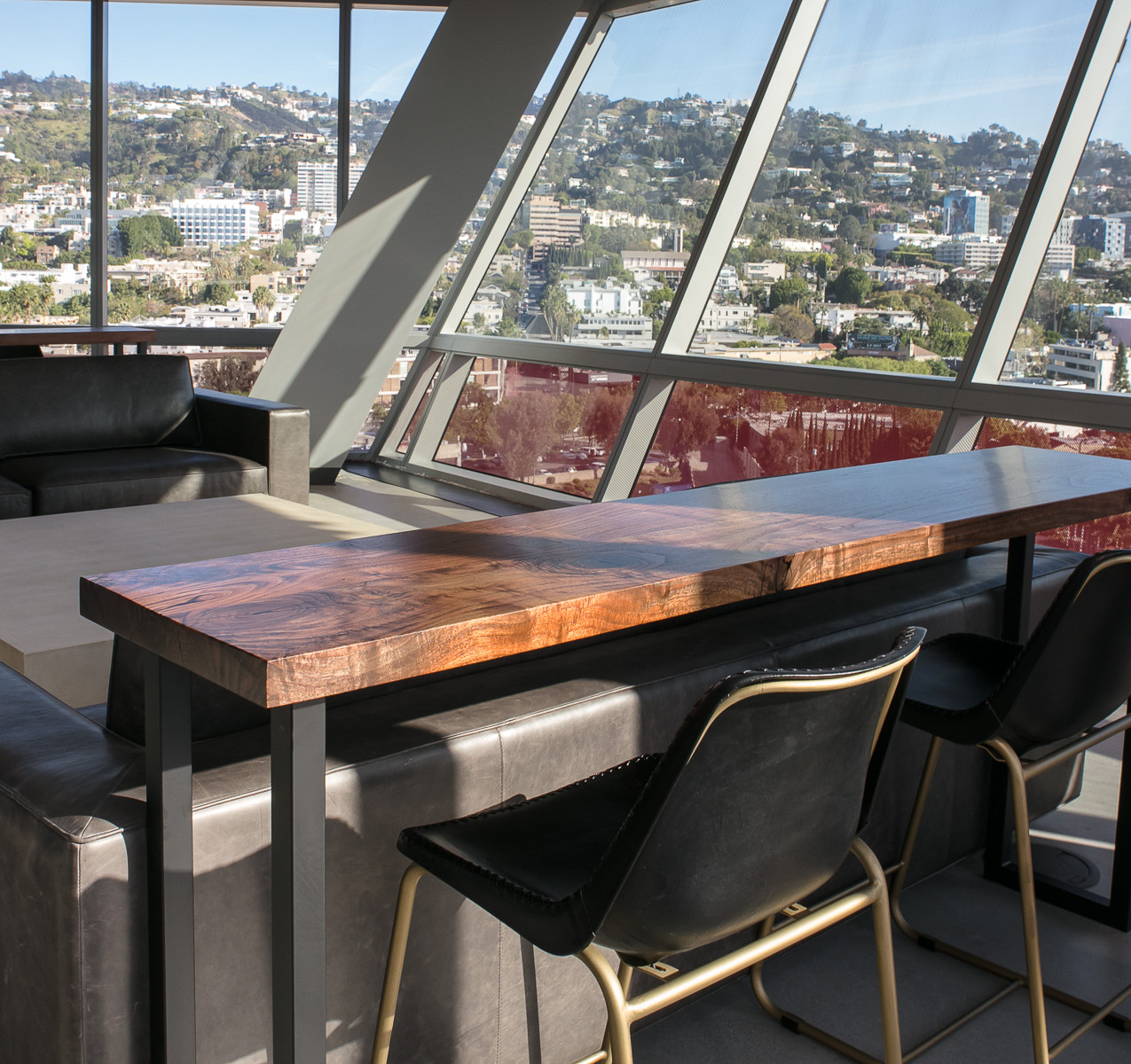 Custom walnut bar top tables for Modern luxury high rise office overlooking hollywood hills