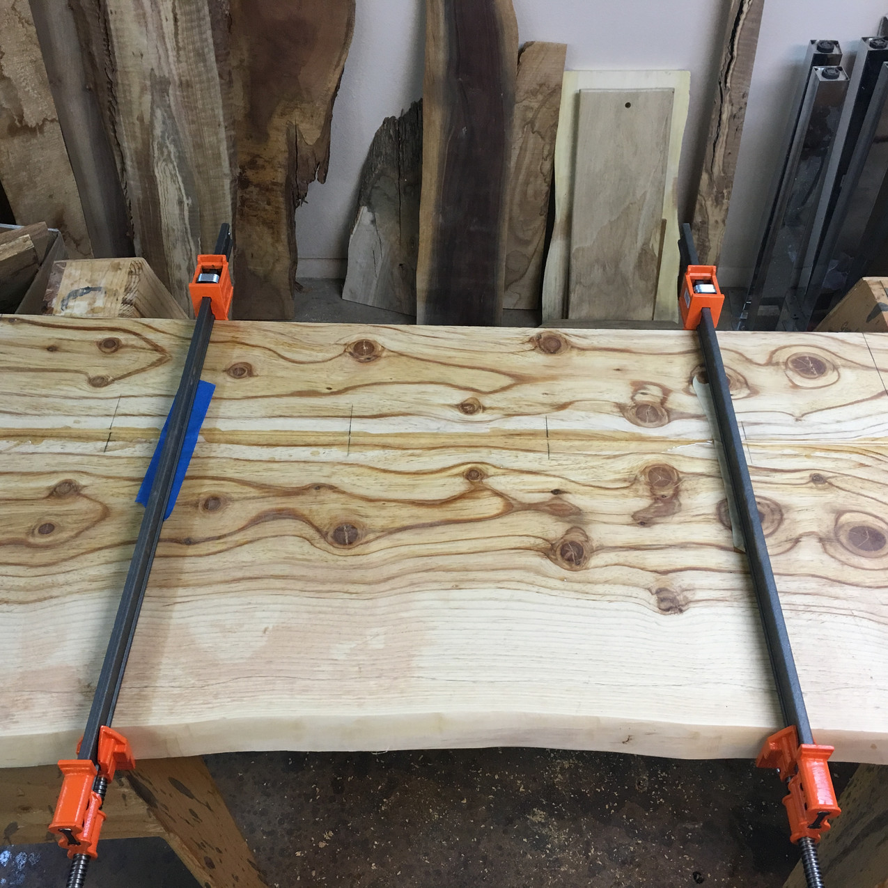 Wood dowel and resin glue up on these bookmatched canary island live edge pine slabs