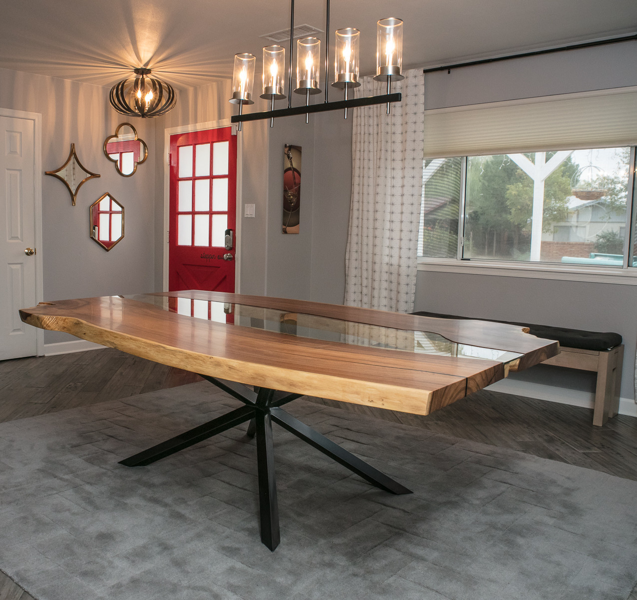 Mesquite Live Edge River Dining Table with glass inlay and modern X base finished in iridescent charcoal gloss