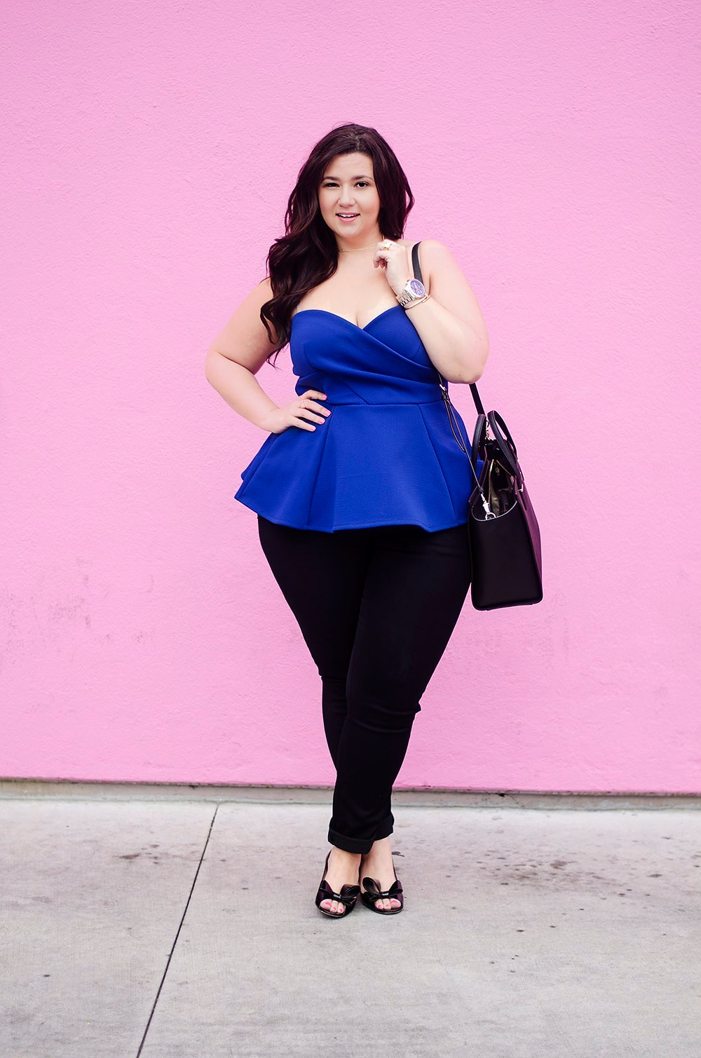 plus size fashion blogger pink wall los angeles city chic eloquii peplum date night crystal coons