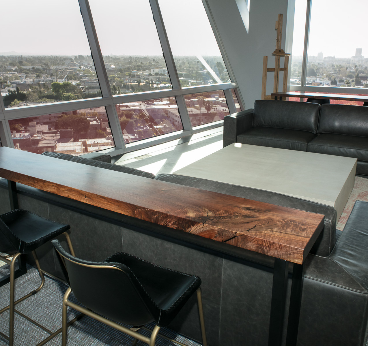 Custom walnut bar top tables for Modern luxury high rise office overlooking hollywood