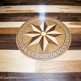 Wooden floor medallion at front entry way