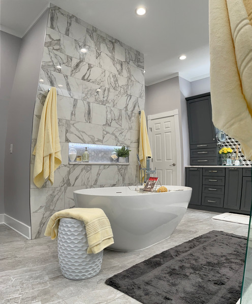 Large soaking tub with tile accent wall