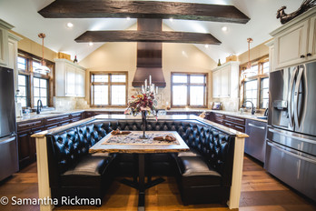 Large kitchen area for gathering with custom booth seating