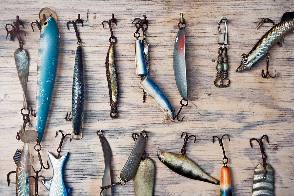 fishing lures hanging on wood wall