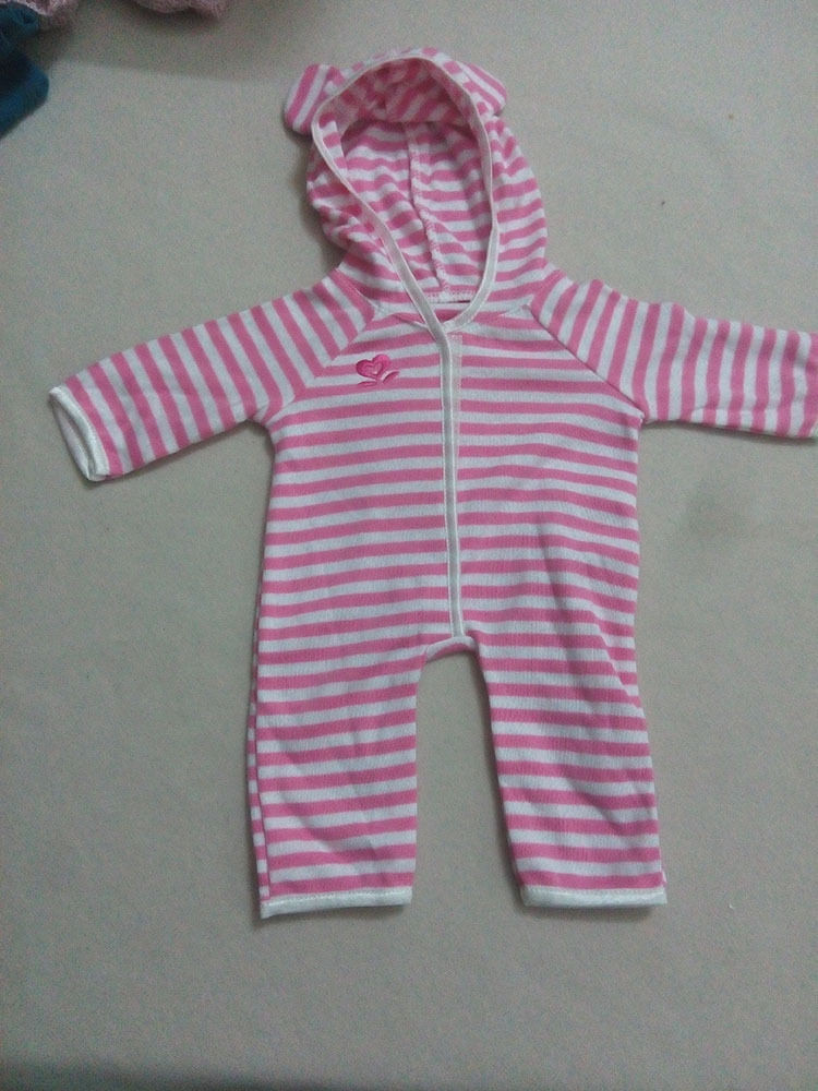 This onesie has white and pink stripes all over it. The front closes with Velcro instead of a zipper, like real onesies do. The hoodie of the onesie has Mickey ears on them.