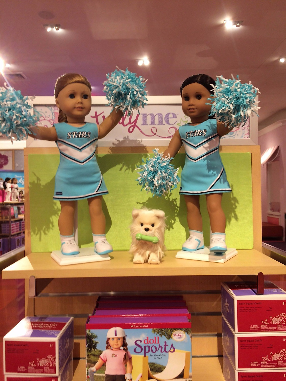 This display shows off the new Spirit Squad Outfit from American Girl ($28). It is shown on #33 and #62. In the middle is the pomperanian puppy that was sold at Costco exclusively and got released on it's own last week. The picture also has the new Doll Sports book in the front.