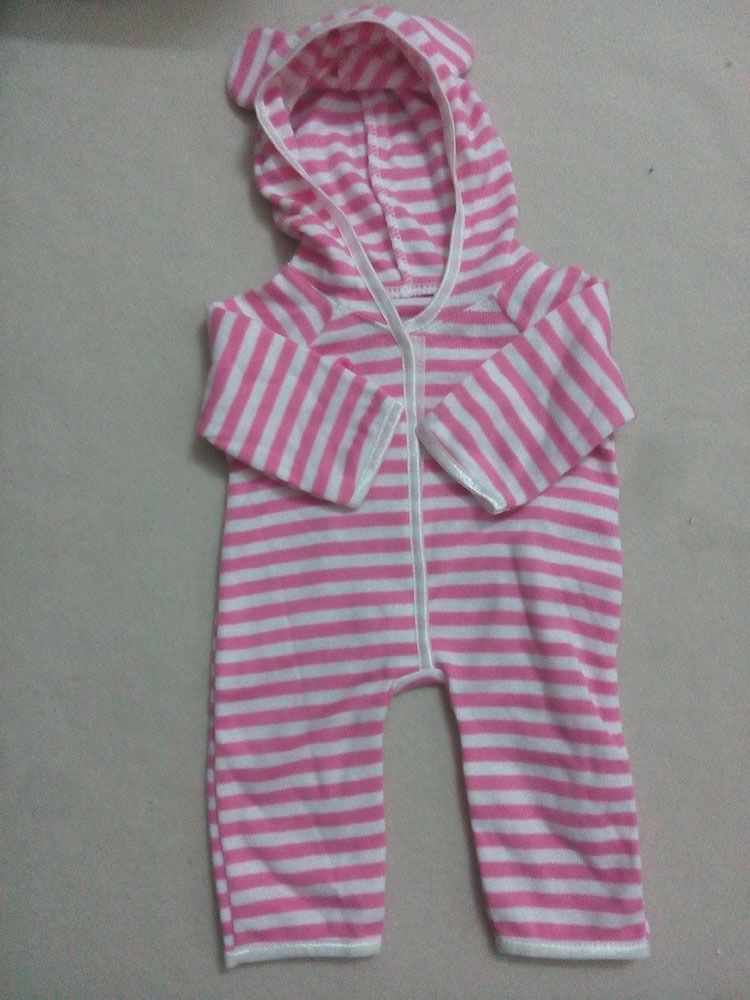 When the baby doll puts her hands in a criss-cross position, the onesie will look like this.