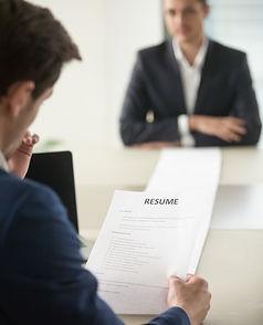 interviewer-reading-applicants-long-resu