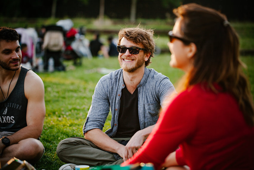 picnic-in-the-park-smiling-conversation-