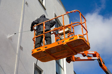 Pressure washing a building
