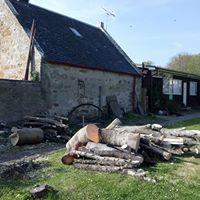Fire wood left outside Dornoch Distillery
