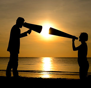Silhouette man and woman with bullhorn m