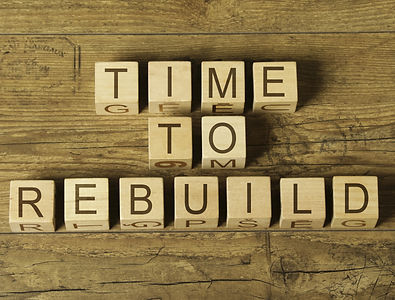 time to rebuild text on wooden cubes on