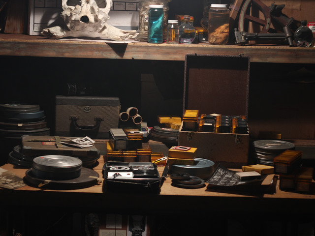 Film cans and media of collector from underground lair set