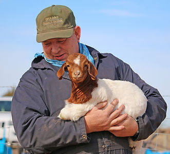Randy Bryant of Bryant Farms with a Boer Goat kid.