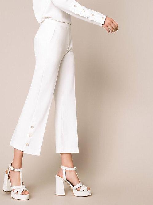 Pantaloni con volant e perle