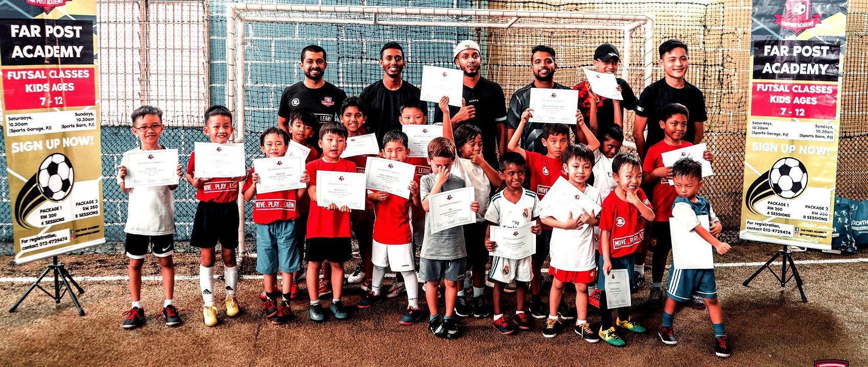 Far Post Academy Futsal Class - Certified futsal coaches and students holding certificates on futsal pitch