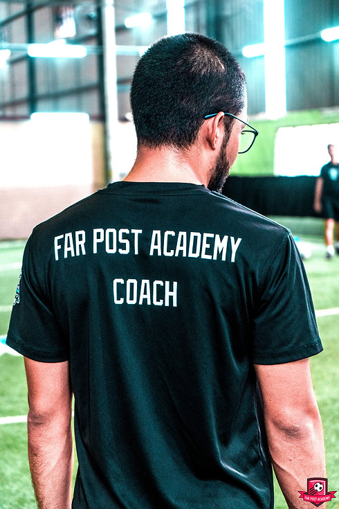 Far Post Academy Certified Coach wearing Far Post Academy Coach black t-shirt