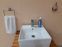 Sanitizer in lobby of 2BHK apartment