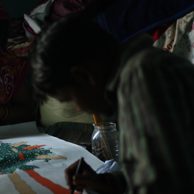 Santosh Marawi and his wife painting tree of life