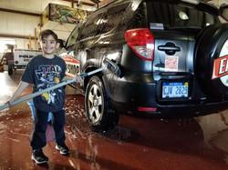 Wyatt keeping Daddys Car Clean!
