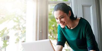 Happy Woman at Computer.jpg