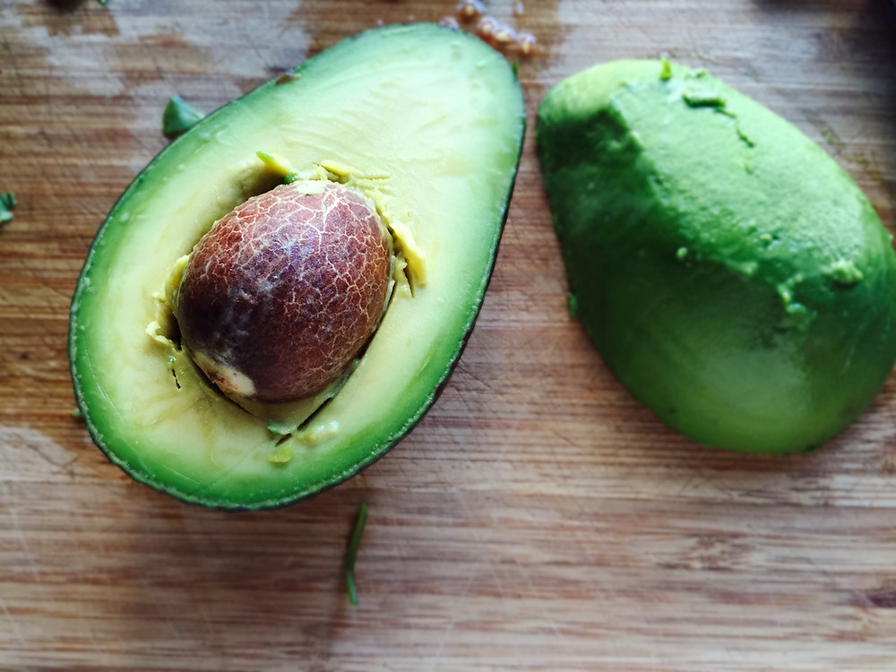A large avocado cut in half.