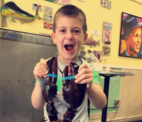 LOTSA LOBSTER - kid with lobster.jpg