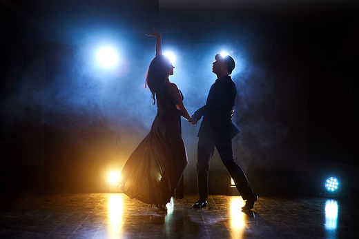 skillful-dancers-performing-dark-room-co