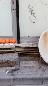Oranges, dish and a black bag of rubbish