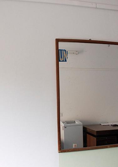 UN mirror in a dead hotel room, occupied