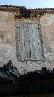 Shutters and distressed roofing