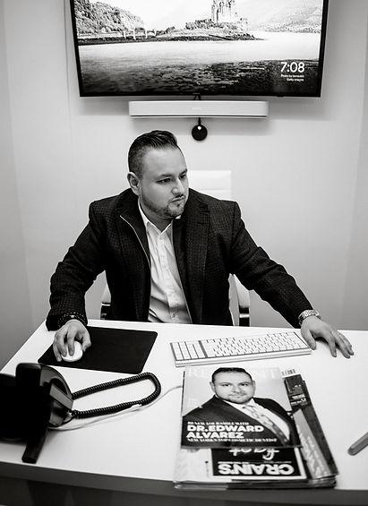 Dr. Alvarez at his desk.jpg