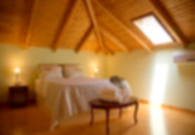 Wooden bedroom at the Country House Olive. Rural Accommodation in Nafplio, Peloponese.Rooms near nature and countryside, next to a farm with homemade products