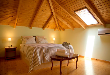 Wooden bedroom at the Olive Country House. Rural Accommodation in Nafplio, Peloponese.Rooms near nature and countryside, next to a farm with homemade products
