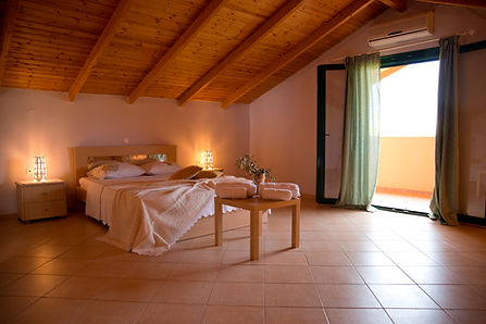 Cosy bedroom at the Pomegranate Country House.Rural Accommodation in Nafplio, Peloponese near nature and farm