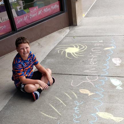 Street artist in front of the studio