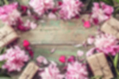 Background with pink peonies and gift bo