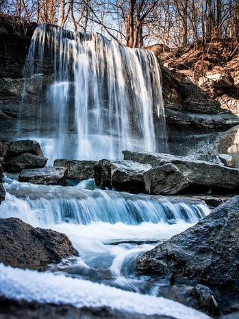 tyler-galbraith-winter-waterfall-unsplas