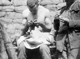 Canadian Soldier Removing Lice – Western Front Witness– Strange Times 1914- WW1 Books– WW1 Stories- Interesting facts about WW1