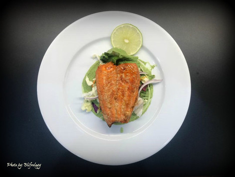 Maple glazed salmon fillet with peas puree.