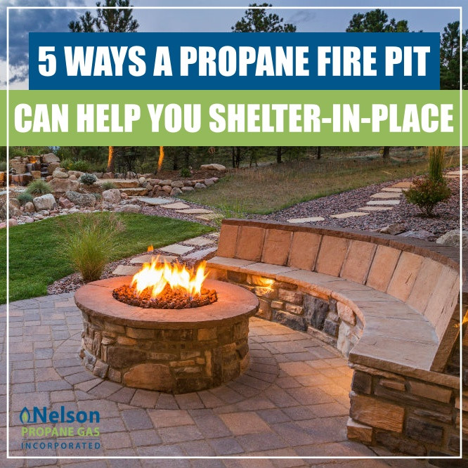 propane fire pit in backyard