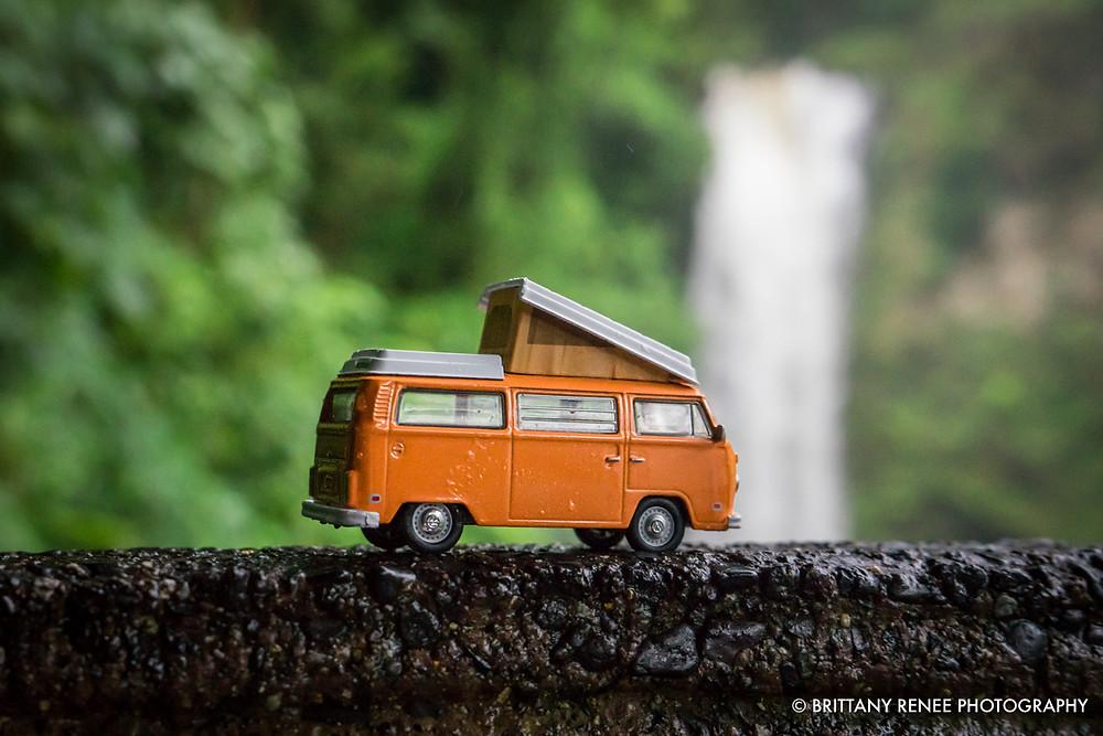 Volkswagen Toy Car in front of Waterfalls