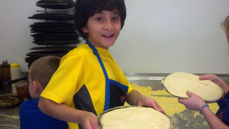 Making pizza's at Dominios