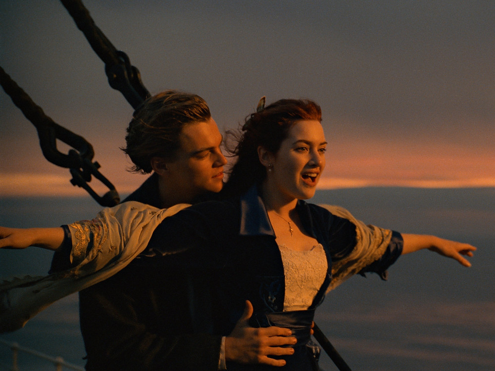 Jack (Leonardo DiCaprio) and Rose (Kate Winslet) standing on the port of the ship in Titanic