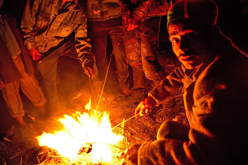 Villagers burning pinewood bark druing pahadi diwali