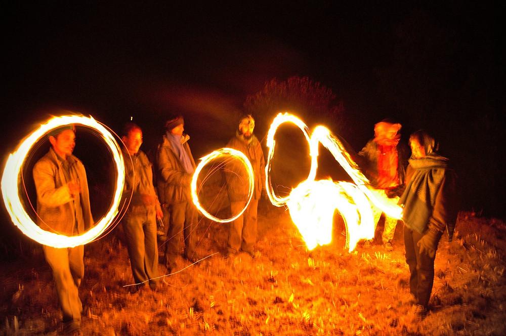 Villagers burning pinewood bark during pahadi diwali