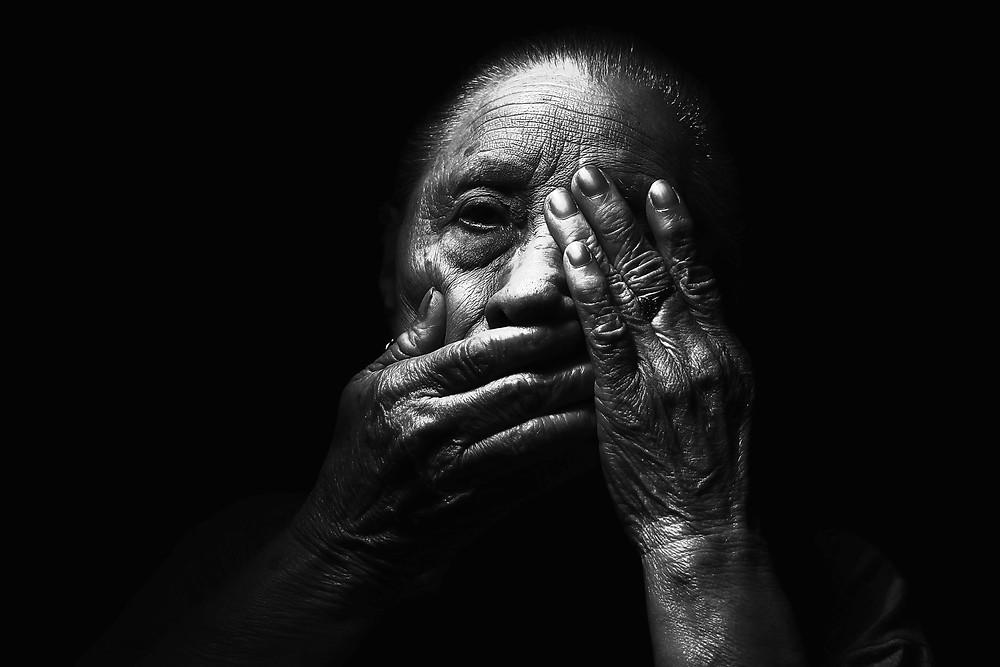 Older woman in the dark