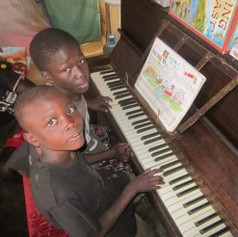 This piano was sent to Uganda in the Africa Equip container.